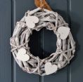 Whitewashed round wreath with wooden hearts